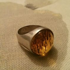 Vintage genuine amber ring Beautiful unique ring. Genuine amber and 925 silver. I'm a 7 and this is small so I'm safely guessing this will fit a 6 1/2. From europe. Jewelry Rings