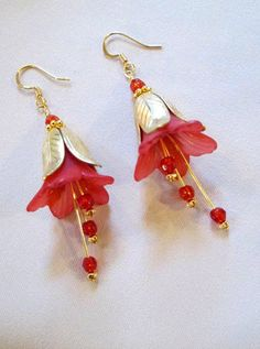 What makes these red lucite flower earrings gorgeous is magnolia leaf bead caps. Stunning!