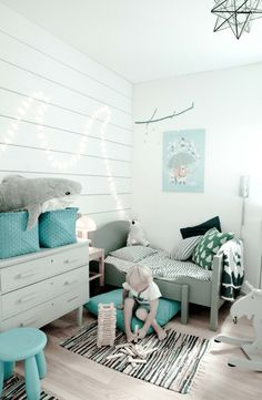 Mint green and white kids room with pop of teal