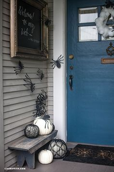 Fun DIY Halloween Decor for the entire family.  We made a spider nest wreath by wiring a circle of white foam balls in different sizes and and covering it with torn white cheese cloth @LiaGriffith.com