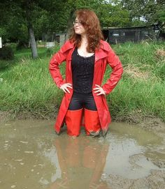 Red Rubber Waders in muddy water