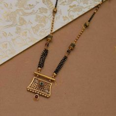 New Antique Mangalsutra designs for women. Get in touch with us on Gold Mangalsutra Designs, Gold Earrings Designs, Necklace Designs, New Gold Jewellery Designs, Diamond Mangalsutra, Gold Designs, Indian Jewellery Design, Handmade Jewellery, Ring Designs