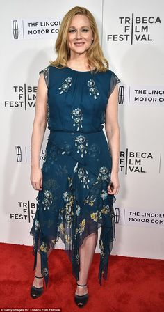 Delightful: Laura Linney, 53, looked gorgeous in a dark blue floaty dress with asymmetrical hem. The sleeveless frock was decorated with white, yellow and blue floral motifs