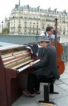Street Musicians ,Ile St Louis, Paris♔PM.  One of the things I love most about European cities, especially Paris, is the variety of street musicians and performers.