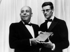 Stanley Marcus presenting Yves Saint Laurent with the Neiman Marcus Fashion Award in 1958. Mr Stanley brought the treasures of the world to Dallas and gave its citizens a taste for glamour.