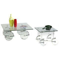 Add flair to your space with this Innovative square glass cocktail table with glass casters.