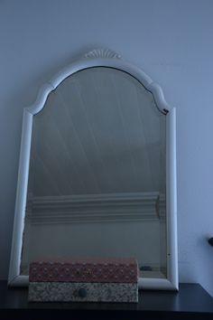Mijn oma's spiegel- hing altijd in de gang