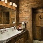 The door with the crescent moon leads to a bathroom designed to resemble an outhouse. Guests are relieved to discover modern plumbing.