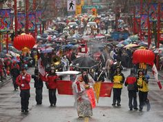 Chinatown Parade in Vancouver style with the umbrella: George Leung, centre, leads the Chinese New Year parade through Chinatown in Vancouver, B.C., on Sunday February 1, 2009. Organizers expected more than 100,000 people to line the parade route to watch.