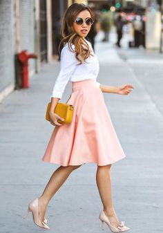 Full skirt in peach, paired with a tailored button-down shirt. Fab work style for the summer!