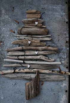 Rustic Christmas. Kids could paint the sticks green, embellish, make gifts to put around with felt and use button or ribbon for bows, etc. - possibilities endless.