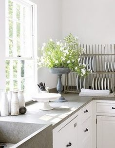 Concrete bench top with classic features in cabinetry. Love it