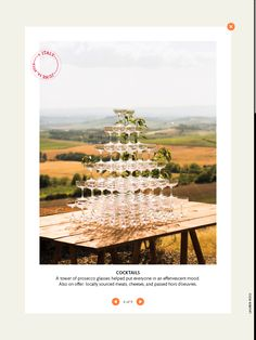 wooden table with glasses for champagne drink as guests enter vineyard. also include mason jars of lemonade and sweet tea. chalk board beside table with program for ceremony.