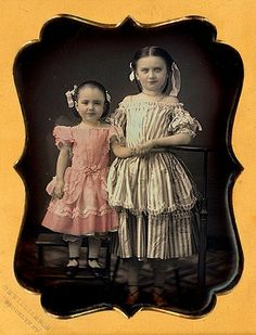 :::::::::: Antique Photograph :::::::::  Oh-my!  Look at these two in their fancy frocks, shoes and hair.  The photographer used a bit of a heavy hand with the tinting on their faces but the detail with everything else is just beautiful.