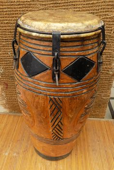 African hand made Djembe drum from Ghana Ghanaian djembe drum is a light wood drum with a small head but an impressive bass, tone, slap definition for its size. A great drum for children, travelers, or adults wanting an affordable first Djembe with an authentic African sound. Please note the Ghanaian Djembe Drum is hand made and therefore every drum is unique. The carvings, fabric, colour and rope may vary from those pictured, while the quality will remain at our high standard. This drum…