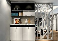 This contemporary style room divider is giving you an extra advantage of storage space in form of a cupboard with cabinets and drawers. the half of the divider has a decorative modern-style screen enhancing the overall contemporary interior of the home.