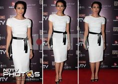 Karisma dressed to impress in a white Paule Ka dress with a black belt at this brunch.
