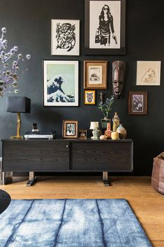 Older artwork combined with modern interiors makes for a home both cool and classy. [Vintage Console, Living Room Ideas, Living Room Decor, Wall Art Display, Artwork For Living Room, Living Room Decorations, Black Wall Accent, Indoor Plants]
