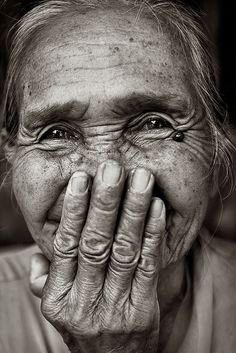 I love this little old woman as she smiles into her hand. TBH0027 copy.jpg by Banhup Teh Photography, via Flickr