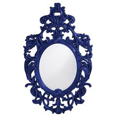 This oval mirror features an ornate open scroll work frame that is finished in a…