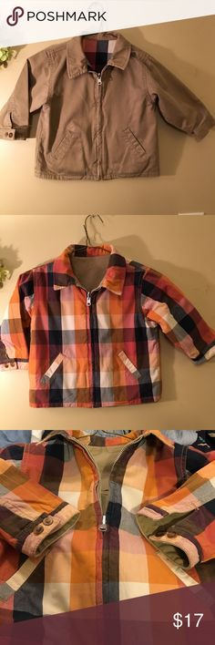 """The Cutest Little Gap Jacket Ever! This Gap Kids Jacket was worn by my son for one short season. It is fully reversible and tag was removed so he could wear it both ways. It's in EUC. From armpit to armpit it measures approximately 14.5"""" and length is approximately 16"""". I have a 5 star average rating. I pride myself on being accurate in my descriptions and listing clothing that is either new or very gently used. Thanks for looking! Gap Kids Jackets & Coats"""
