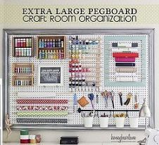 I love the frame around this peg board. Craft Room Organizational Pegboard.