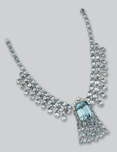 AQUAMARINE AND DIAMOND CLIP/NECKLACE.  CENTER PIECE DETACHES TO BE USED AS A BROOCH, CIRCA 1935
