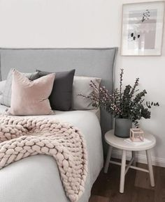 Layer up textured cushions in complimenting colours to create a cosy and inviting bedroom space. We love this use of dusty pink and slate grey, match with a classic white bedspread for a sophisticated and comfortable style.