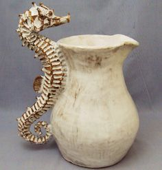 Pitcher with seahorse for a handle.