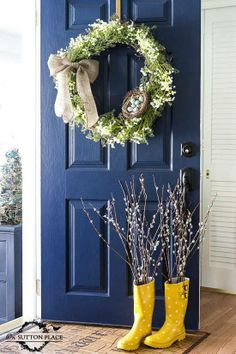 Love the color of the front door! Love the rubber boots with flowers!