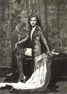 """""""Sexy women often posed dressed in a lace table cloth, in an attempt to seduce local restaurant owners in 1929.  It was a custom at the time..."""""""