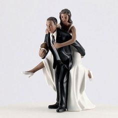 Use this adorable football couple cake topper for your wedding via Unity Wedding Boutique