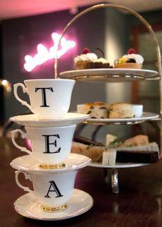 High Society Tea: three tea cups and three tiers of goodies