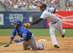 Tag you're out - New York Yankees shortstop Didi Gregorius makes a double play as he tags out Toronto Blue Jays' Edwin Encarnacion between first and second base before flipping the ball to first for the force out on Toronto Blue Jays Justin Smoak during the eighth inning of a baseball game on Aug. 8 in New York. - © Julie Jacobson/AP Photo