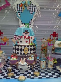 Incredible cake at an Alice in Wonderland birthday party! See more party planning ideas at CatchMyParty.com!
