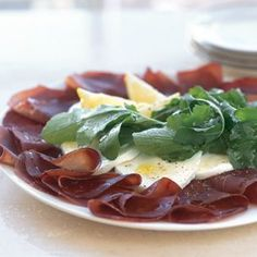 Bresaola (salted, air-dried beef with a sweet aroma and rich flavor and leaner than prosciutto) with arugula and mozzarella. Serve as antipasto or as a main course in the summer. Pairs well with Franciacorta (a sparkling wine from Lombardy) or juicy, medium-bodied red wines.