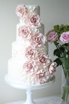 in love with this romantic sugar rose adorned wedding cake by Ivory & Rose