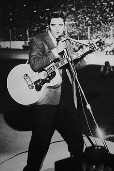 Elvis onstage at the Cotton Bowl, Dallas Texas  - Oct 11, 1956 |  Photo courtesy webb  |  The first performance that Elvis was pictured using his new 1956 Gibson J-200.-