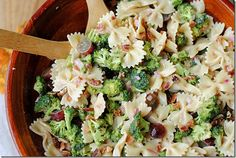 Broccoli Grape Salad    1/2 (16 oz) box whole wheat farfalle (bow-tie) pasta  1 lb. fresh broccoli  1/2 cup light mayonnaise  1/2 cup non-fat plain yogurt  1/3 cup sugar  1/3 cup diced red onion  1/3 cup red wine vinegar  1 tsp. salt  2 cups seedless red grapes  6 cooked turkey bacon slices, crumbled  1/4 cup chopped pecans