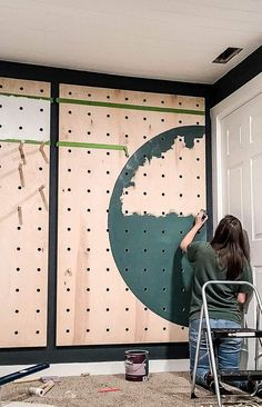 We are so in love with our giant pegboard wall in our recent renovation that we want to share all the details! earn how to make a giant pegboard wall in our post! #DIY #wall #giant Upcycled Crafts, Painting Tips, Painted Furniture, Thrifting, Craft Projects, Wall, Repurpose, Budget, Walls