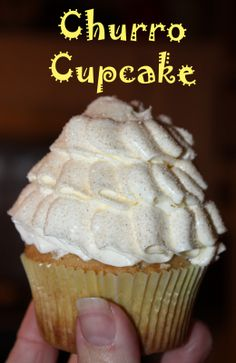 Cinnamon cupcake with Dulce de Leche Filling, topped with Swiss meringue & dusted with cinnamon sugar