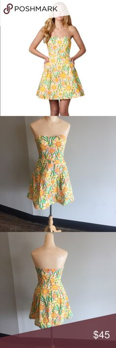 "Lilly Pulitzer Blossom Dress Dobby Sz 0! Strapless dress with a full skirt. Hand wash cold with like colors. 30"" long from top to hem. Invisible zipper with hook and eye at top. Includes pockets! Vintage honeycomb dobby. Imported. Shell and lining both 100% Cotton. Hand Wash cold with like colors, use non chlorine, bleach if needed. No wringing or twisting. Hang or lay flat to dry. Cool iron if necessary. Or dry clean. ***few spots on dress, pictured above. Doesn't take away from dress…"