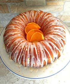 This Orange Bundt Cake with a light orange glaze is my latest attempt at pleasing his sweet tooth. Orange Bundt Cake with Orange Glaze - orange bundt cake with orange glaze Orange Juice Cake, Orange Bundt Cake, Recipe For Orange Marmalade Cake, Orange Cake Recipe From Scratch, Orange Cakes, Orange Fruit, Fudge, Orange Dessert, Cake Recipes