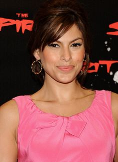 Eva Mendes Gold Hoops - Hoop earrings are an excellent choice to accent an updo.