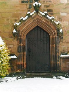 Arched door of St Mary's Church in Aldridge Staffordshire England.