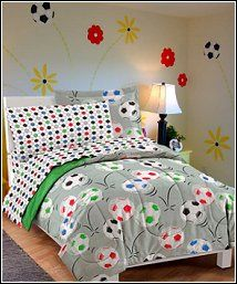 Kick it and make that goal with this Soccer complete bedroom ensemble! The ultra soft comforter and sham feature an allover design of colorful soccer balls in shades of white, green, blue, black and red on a gray ground; the comforter reverses to solid green. A coordinating sheet set showcases a multicolored geometric pattern