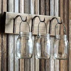 Overwhelmingly gorgeous, these rustic appeal hanging canning jars are perfect for organizing and great as wall planters. Create a stunning mason jar herb garden that will bring vintage charm to any space. Mason Jar Crafts, Mason Jar Lamp, Hanging Mason Jars, Bottles And Jars, Glass Jars, Rustic Decor, Farmhouse Decor, Farmhouse Style, Mason Jar Herb Garden