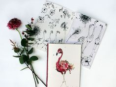 The inner cover of Anna's Flamingo notebook is filled with sketches of flamingos, flowers and squiggles. Anna Wright Flamingo Scribblebook: