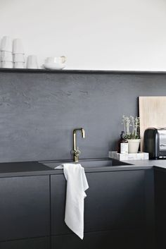 Nina-Holst-Stylizimo-kitchen-DIY-black-backsplash-Remodelista-2