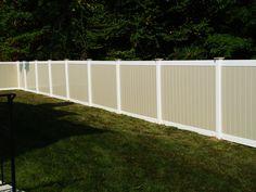 tan and white V300 vinyl yard enclosure